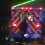Wounded dispensary employee in ambulance