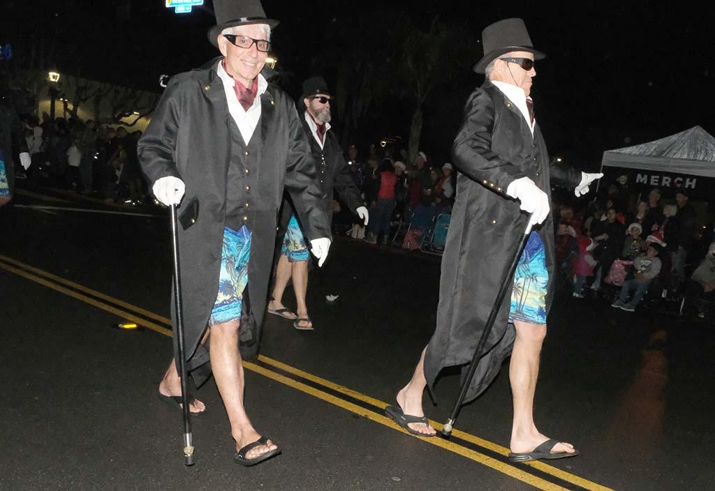 Only in the Ocean Beach Holiday Parade do gentlemen wear flip-flops and beach shorts under formal attire.