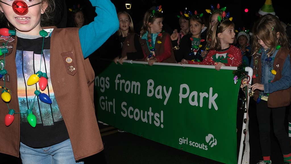Bay Park Girl Scouts came well-lit for the Ocean Beach Holiday Parade
