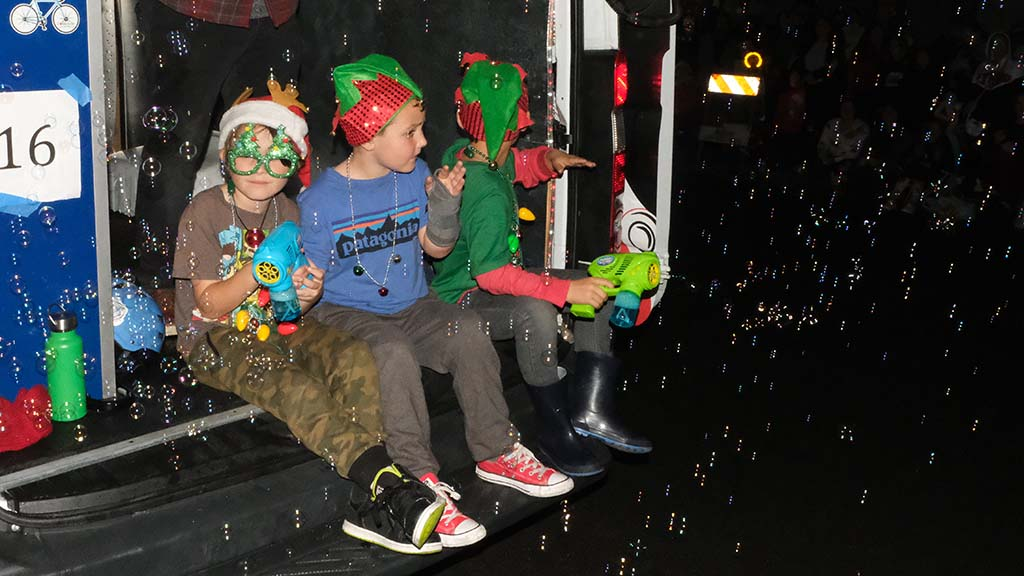 Bubble-blowing guns made for a dazzling display at the Ocean Beach Holiday Parade.