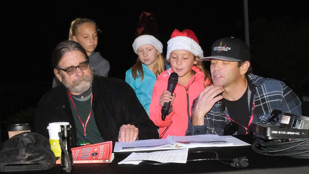 Parade announcer for the fifth or sixth year, Frank Gormlie (left) shared mic duties with some kids at Sunset Cliffs intersection booth.