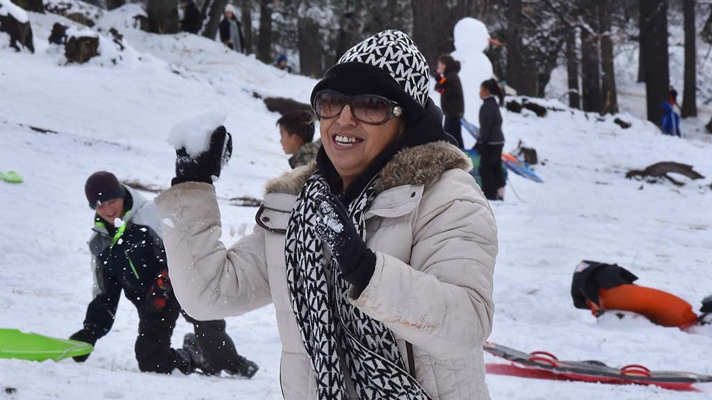 Marta Contreras of San Diego throws a snowball at her daughter in a friendly snowball fight.
