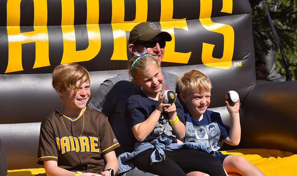The Prosi family of Encinitas relaxed on an inflatable couch at FanFest.