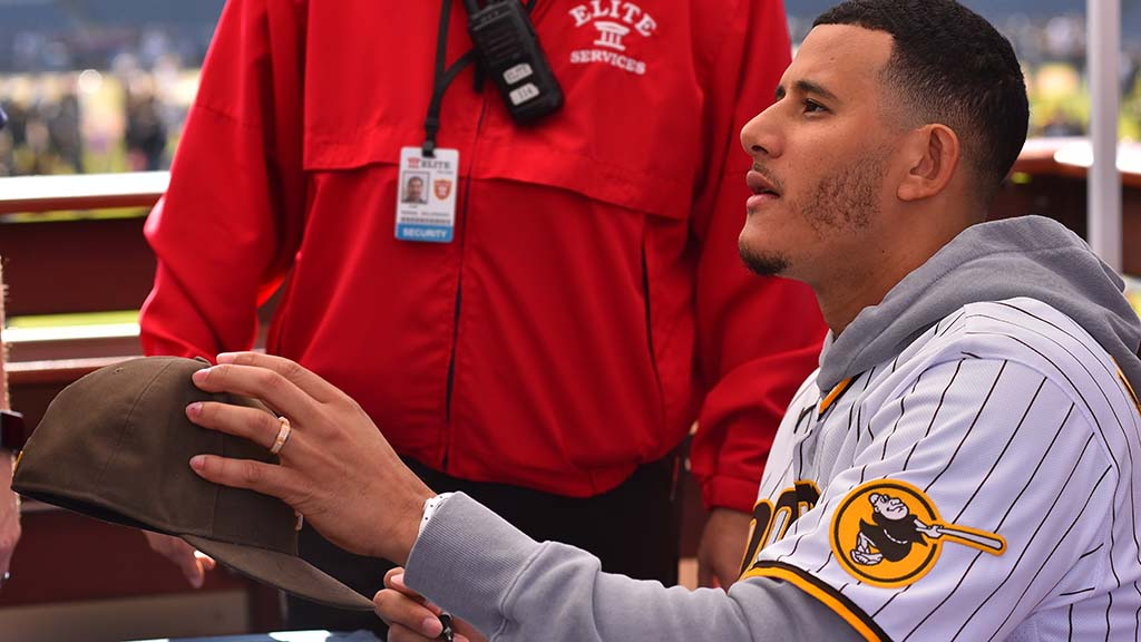 Third-baseman Manny Machado signs autographs for fans at Padre FanFest.