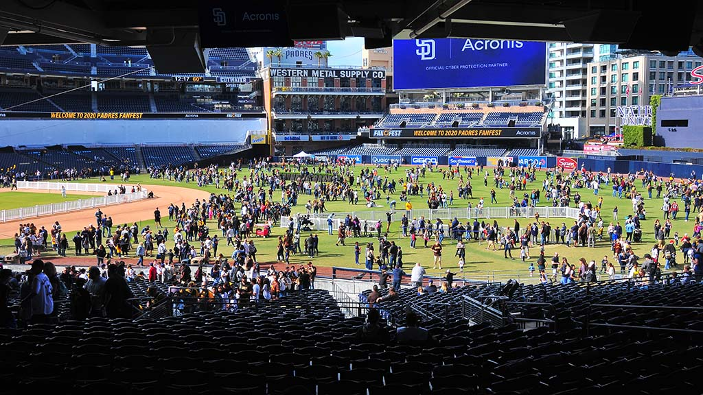 Thousands of baseball fans play catch and take photos on the field at Petco Park during FanFest.