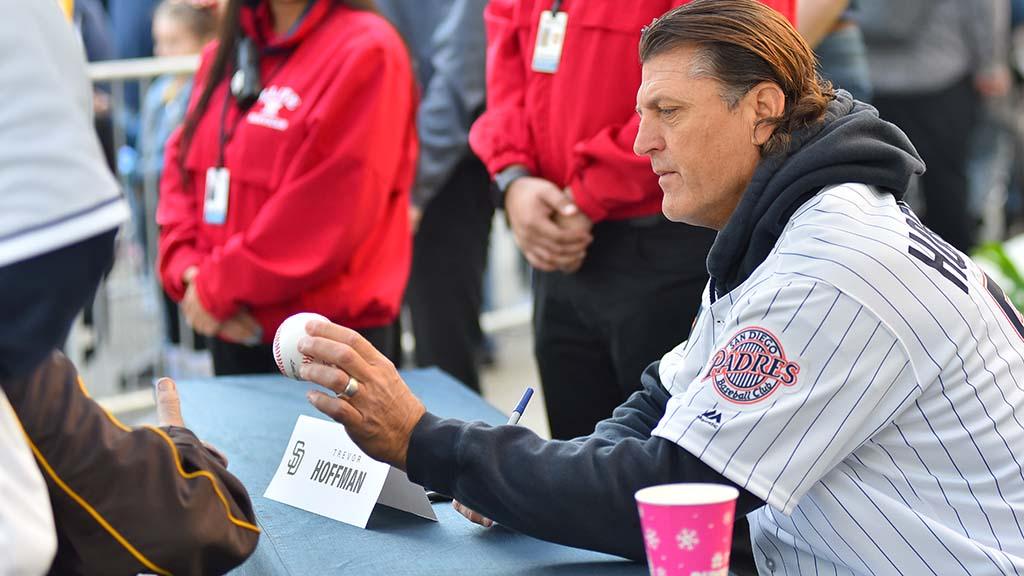 Padre Hall of Famer Trevor Hoffman signs baseballs for fans at Padres Fan Fest.