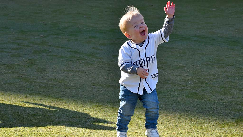 Two-year-old Cooper Pfohl of Temecula had a ball playing with his sister, Rory, on the field at Petco Park at Fan Fest.