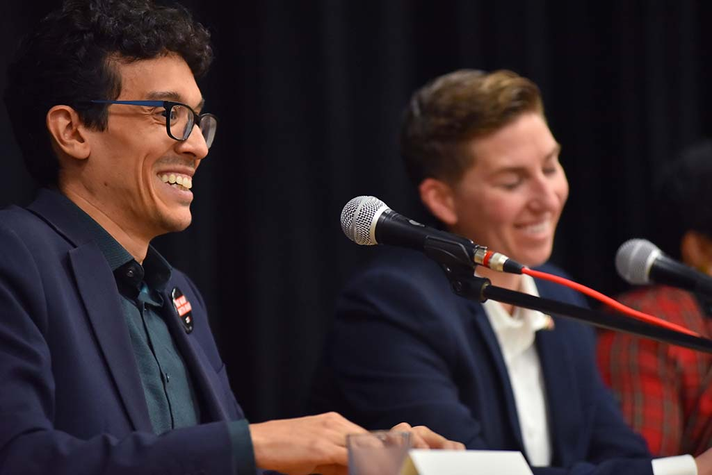 Fellow military veterans Jose Caballero and Janessa Goldbeck share a light moment in a debate where the audience was encouraged to laugh but not cheer or jeer