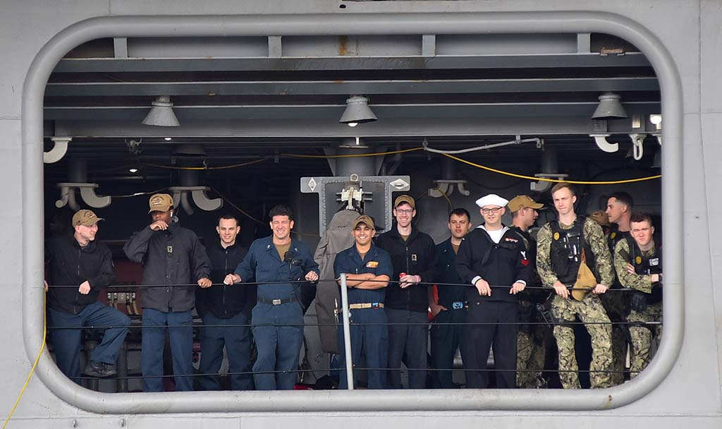 USS Abraham Lincoln crew members wait to disembark after a 10-month deployment.