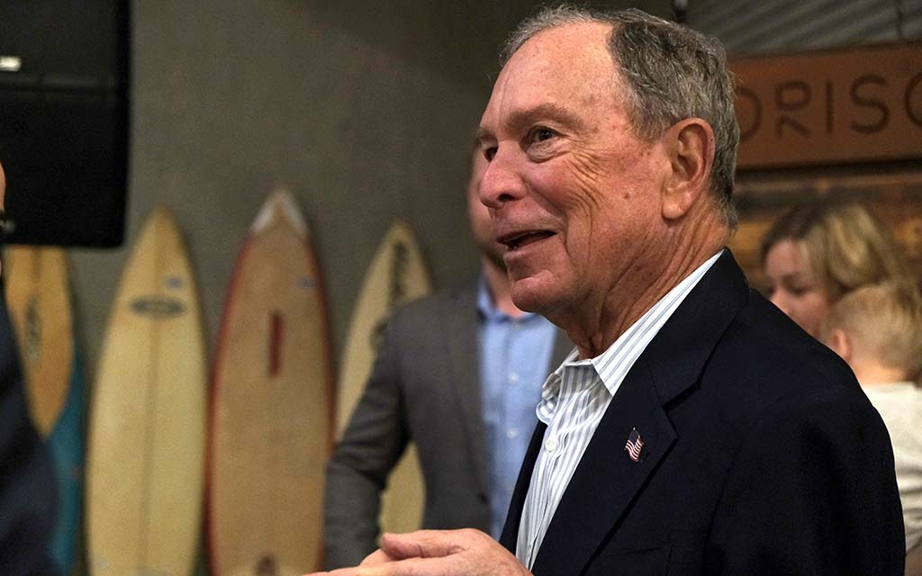 Presidential candidate Mike Bloomberg chats with veterans after remarks at Fuse, a Linda Vista firm that employs veterans.