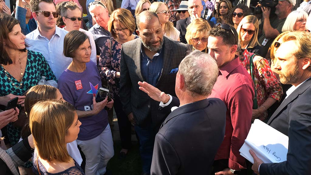 Presidential candidate Mike Bloomberg speaks with gun control proponents after a talk at the home of San Diego City Council candidate Wendy Wheatcroft.