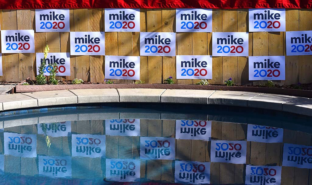 San Diego City Council candidate Wendy Wheatcroft decorated her back yard with Mike Bloomberg posters for the Sunday event.