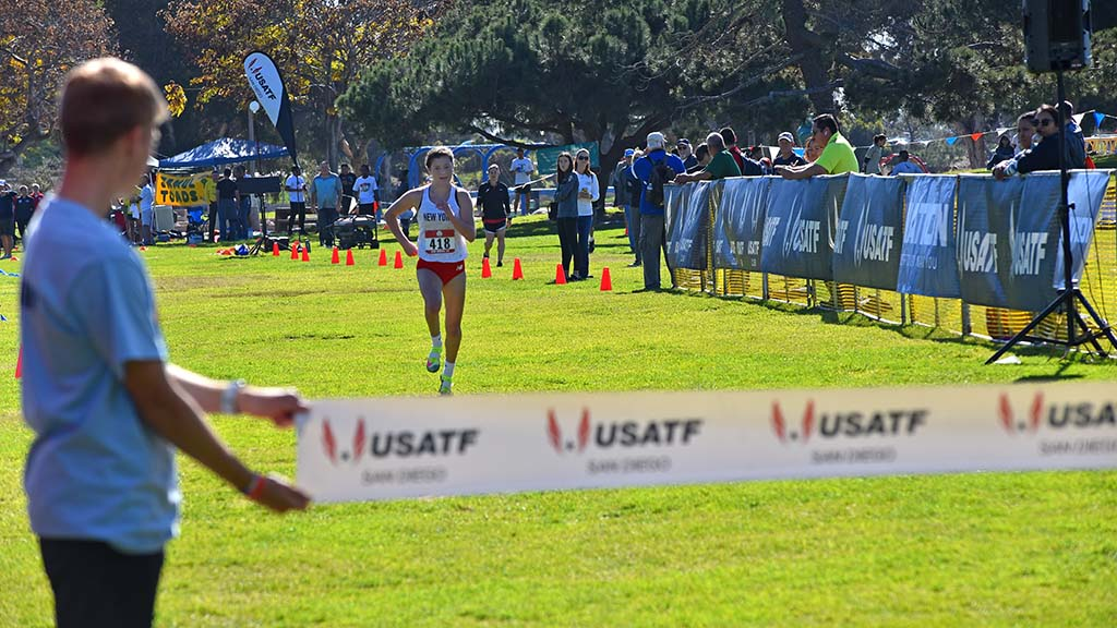 Brooke Rauber of Homr NY nears the finish line alone in the junior women race in the USATF Cross Country Championship.