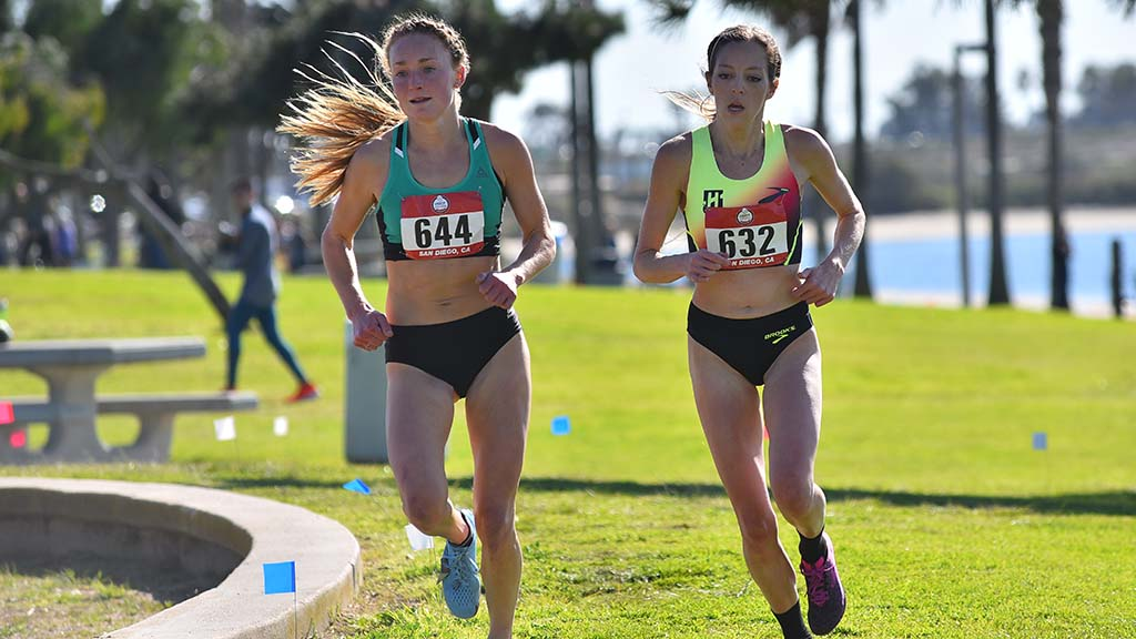 Paige Stoner (left) and Natosha Rogers battle for first place in the senior women race in the USATF Cross Country Championships.