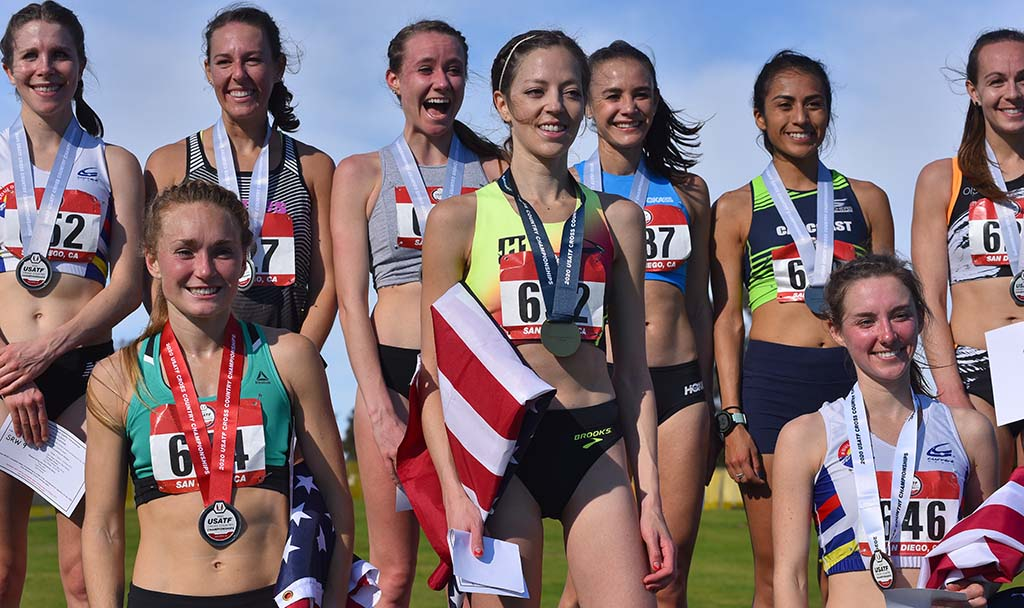 The top 10 finishers in the senior women race pose with their medals.