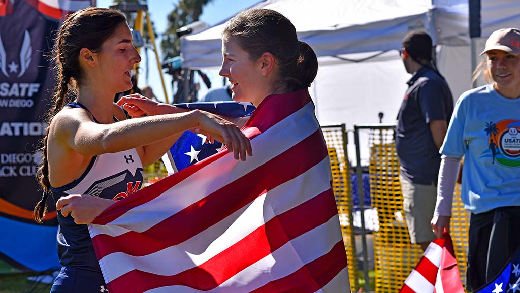 Winner Brooke Rauber (right) of Homer NY Club congratulates Rayna Stanziano of St. Mary's on her second place finish in the junior women 6k race.