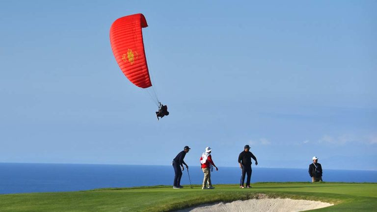 Pro-Am players on Wednesday are joined by a paraglider at the Farmers Open Golf Tournament at Torrey Pines Golf Course in La Jolla. Photo by Chris Stone