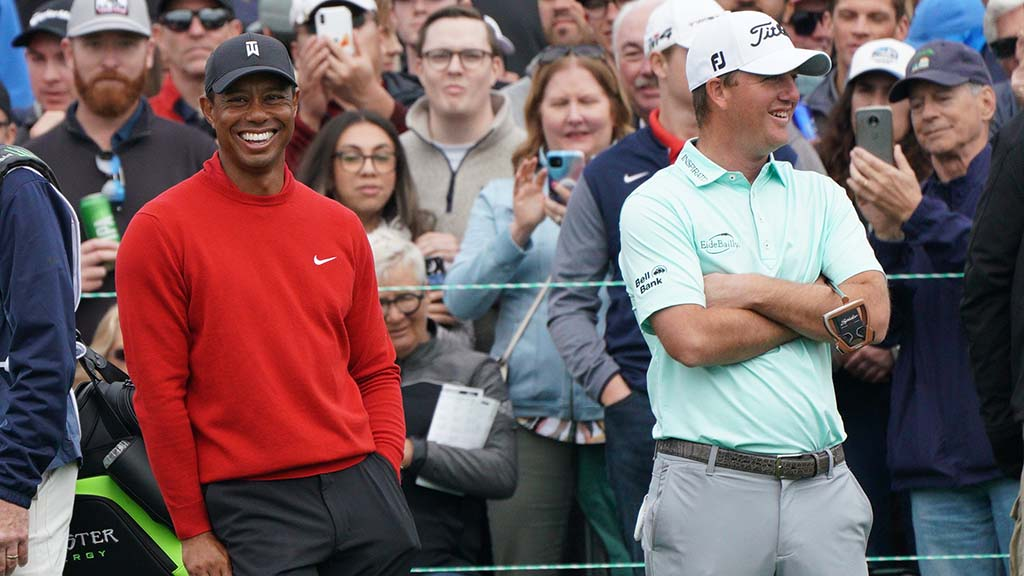 Tiger Woods (left) and Tom Hoge share a laugh at the 18th green of the south course of the Farmers Insurance Open.