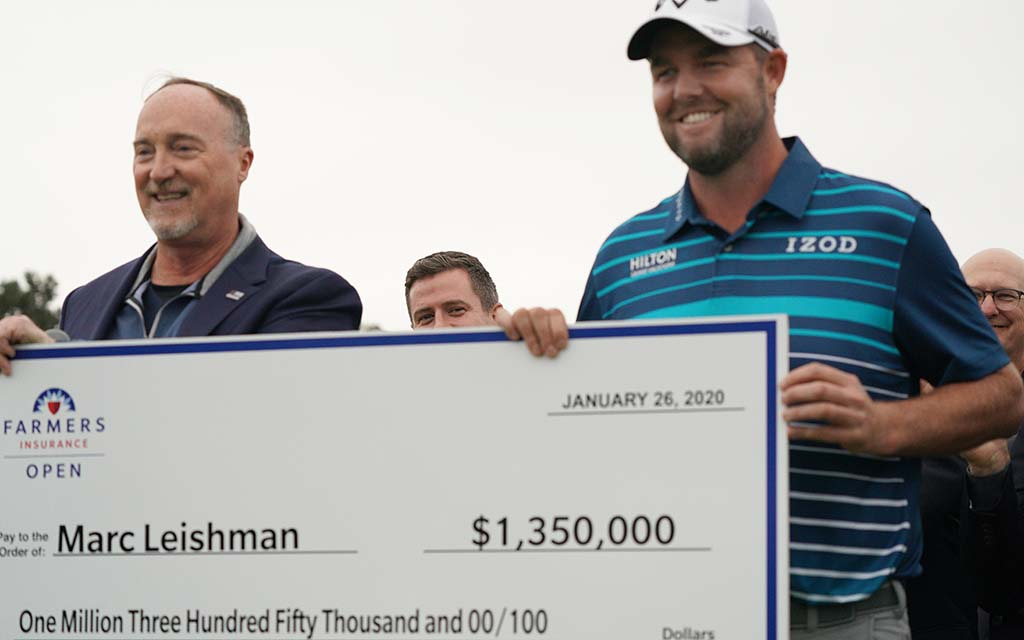 """Winner Marc Leishman holds his $1.3 million """"check"""" at the Farmers Insurance Open on the Torrey Pines Golf Course."""