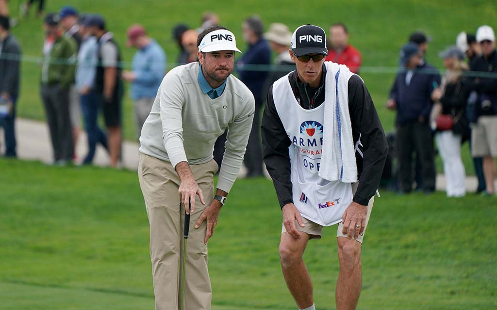 Bubba Watson and his caddie contemplate the next shot on the south course of the Farmers Insurance Open
