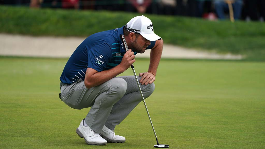 Winner Marc Leishman eyes his last put on the 18th green of the Farmers Insurance Open on Jan. 26.
