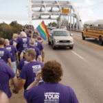 Chorus members approach Edmund Pettus Bridge in Selma