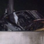 Charred wreckage of car