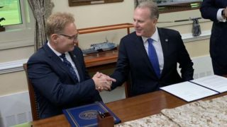 Secretary of the Navy Thomas Modly and San Diego Mayor Kevin Faulconer shake after signing agreement involving Point Loma site.