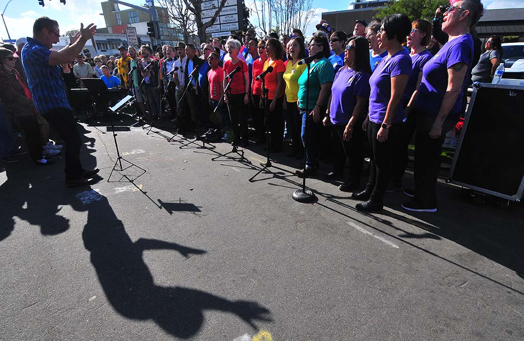 """Artistic Director of the San Diego Gay Men's Chorus, Jerry R. Foust, directs his chorus and the San Diego Women' Chorus in singing """"Somewhere Over the Rainbow."""""""