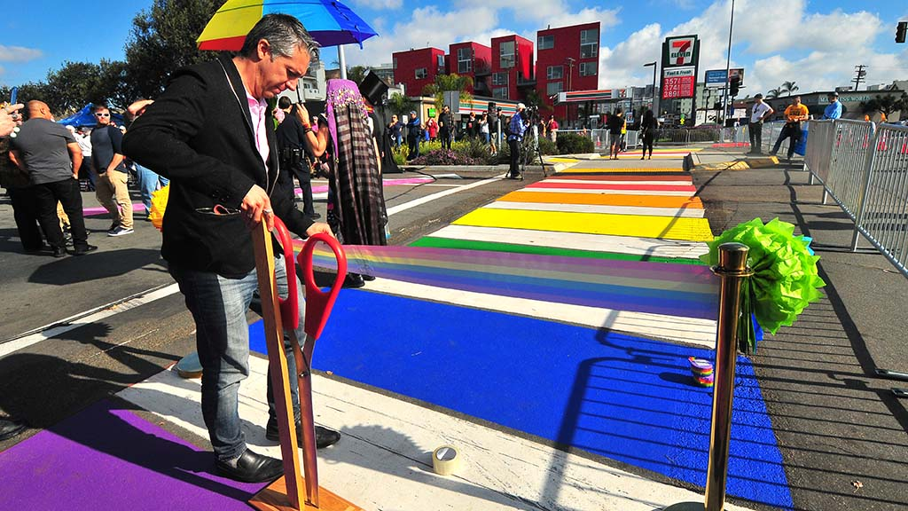Eddie Reynoso, executive director of Equality Business Alliance, readies for the ribbon cutting ceremony for the rainbow crosswalk in Hillcrest.