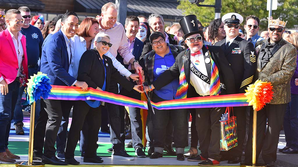 Local politicians and LGBTQ supporters join in the ribbon cutting ceremony for the city's new rainbow crosswalk in Hillcrest.