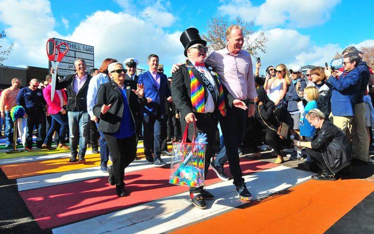 Honorary Mayor of Hillcrest Nicole Murray-Ramirez and San Diego Mayor Kevin Faulconer lead the way across the new rainbow crosswalk in Hillcrest.