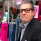 La Mesa shop owner Peter Carzis confronts media outside his store.