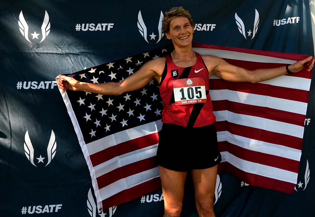 Lorilynn Bloomer, 47, poses with her winner's flag after taking the masters women's race by 17 seconds.
