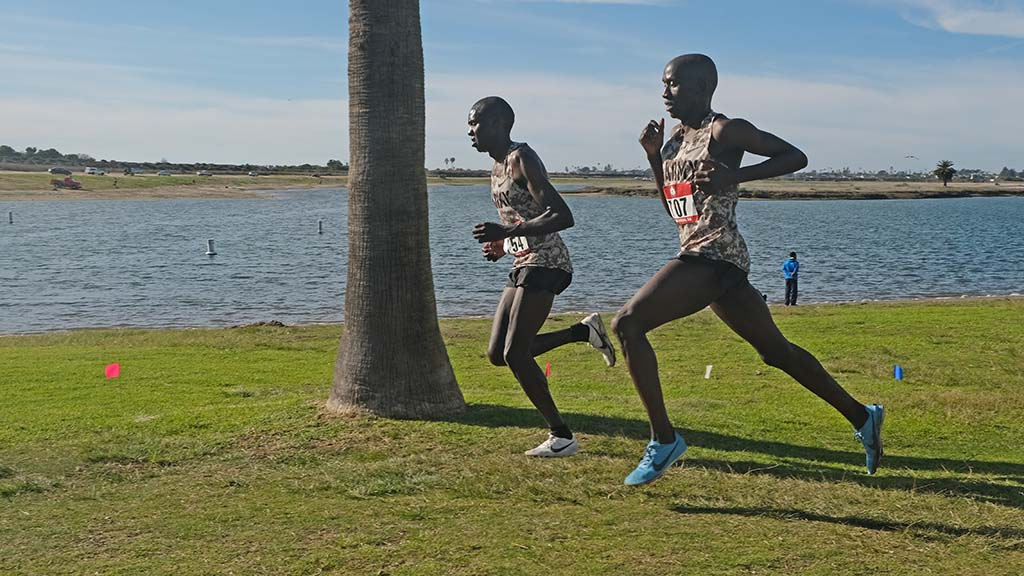 With Mission Bay as backdrop, Anthony Rotich (left) and Emmanuel Bor pace each other in what the winner called a test of fitness.