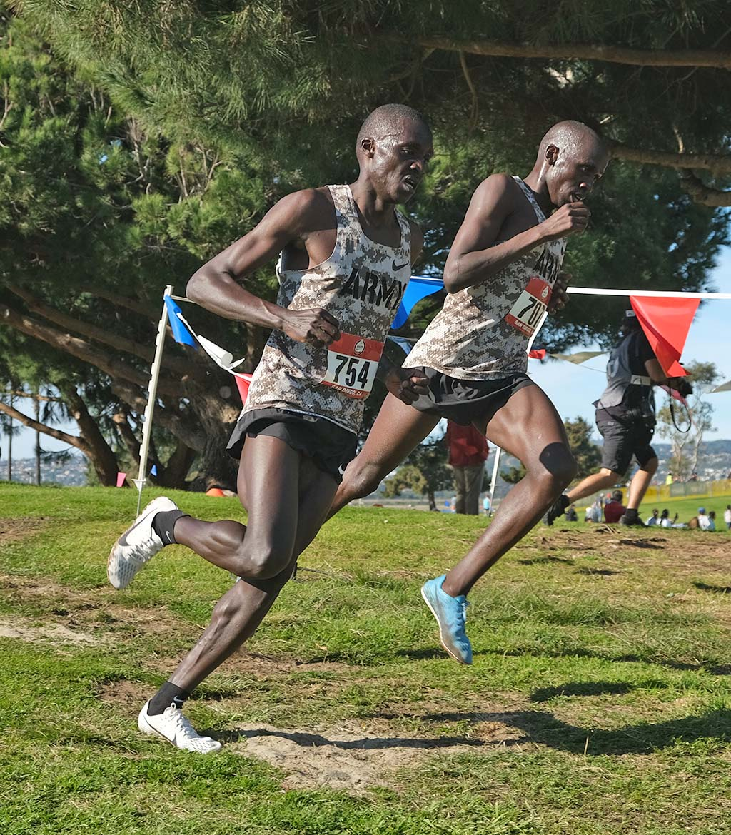 Army World Class Athlete Program teammates Anthony Rotich (left) and Emmanuel Bor head down hill together.