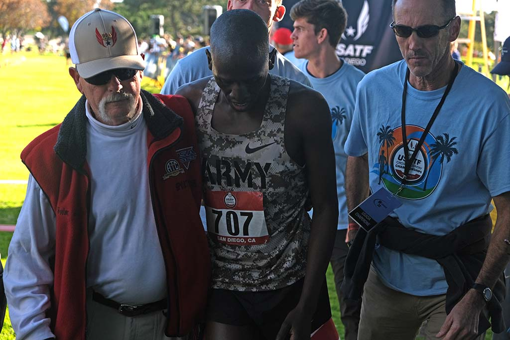 A medic helps Emmanuel Bor, who finished with a painful blister.