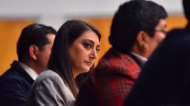 Sara Jacobs eyes top rival Georgette Gómez on debate stage at La Mesa Community Center.