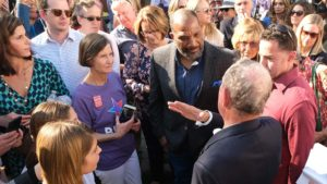 Carol Landale (in purple shirt) and Bishop Cornelius Bowser were among invited guests at Wendy Wheatcroft's home able to quiz Mike Bloomberg, Democratic candidate for president.