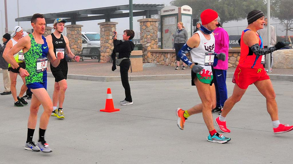Pablo Gomez (red at right) encouraged Chris Mosier (left) to become a competitive race walker.