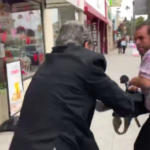 Peter Carzis is shown attacking a KUSI videographer outside his La Mesa shop.