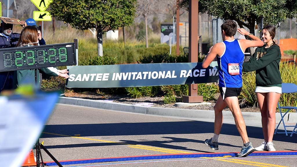 Andres Gonzalez-Aquino, 17, of Tijuana takes the 10K invitational race in Santee, clocking 47:10.