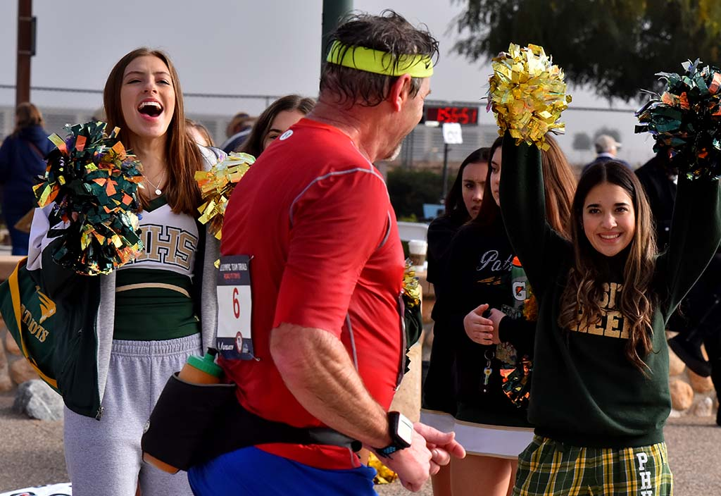 Patrick Henry High School cheerleaders encourage Dave Talcott, 59, of Oswego, New York.