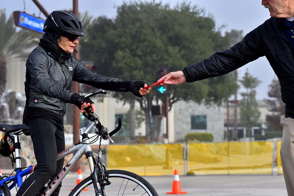 World-class masters walker Jolene Steigerwalt of Rancho Bernardo rode a bike around the 1.25-mile course to collect infraction cards from judges.