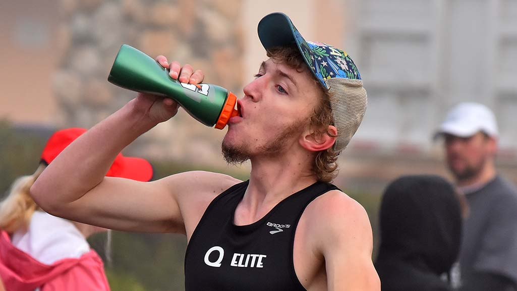 Nathan Vanderwall, 27, of Grandville, Michigan, squeezes out hydration during Olympic Trials 50K walk.
