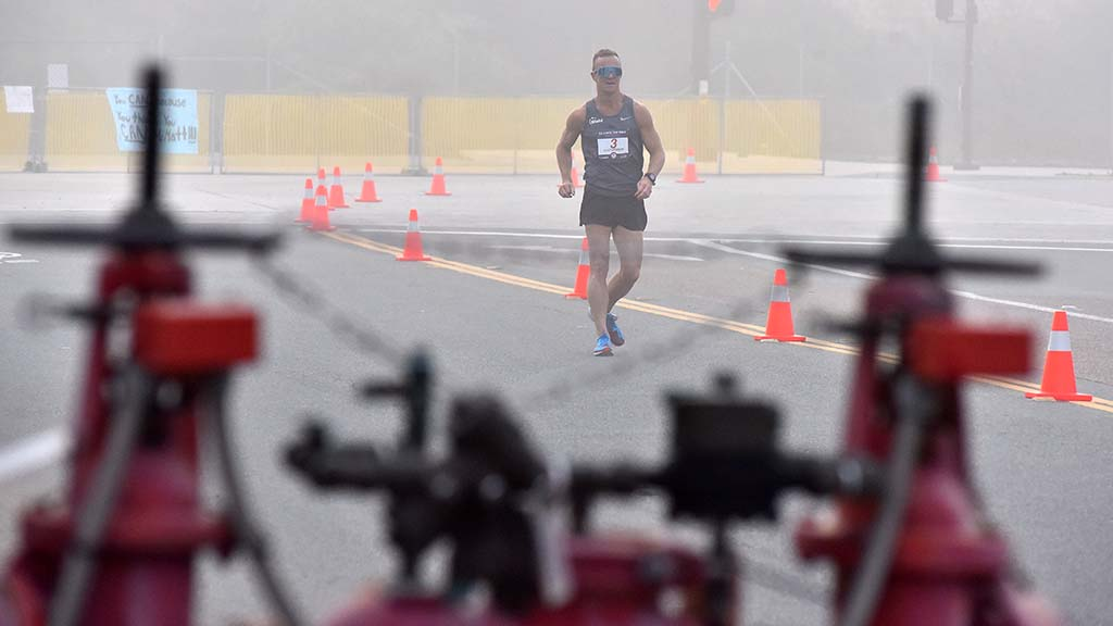 Eventual race winner Andreas Gustafsson appears to walk alone on closed-off Town Center Parkway in Santee.