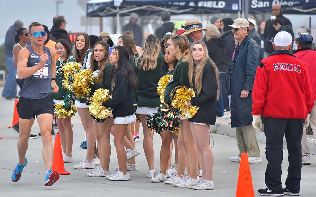 Andreas Gustafsson passes Patrick Henry High School cheerleaders on the way to winning $10,000 and Olympic Trials 50K title.