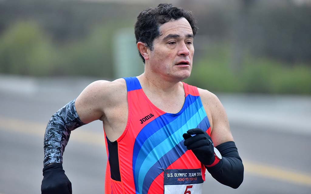 DePaul University neuroscience professor Pablo Gomez, 47, of Evanston, Illinois, kept his arms warm for a 7 a.m. start.