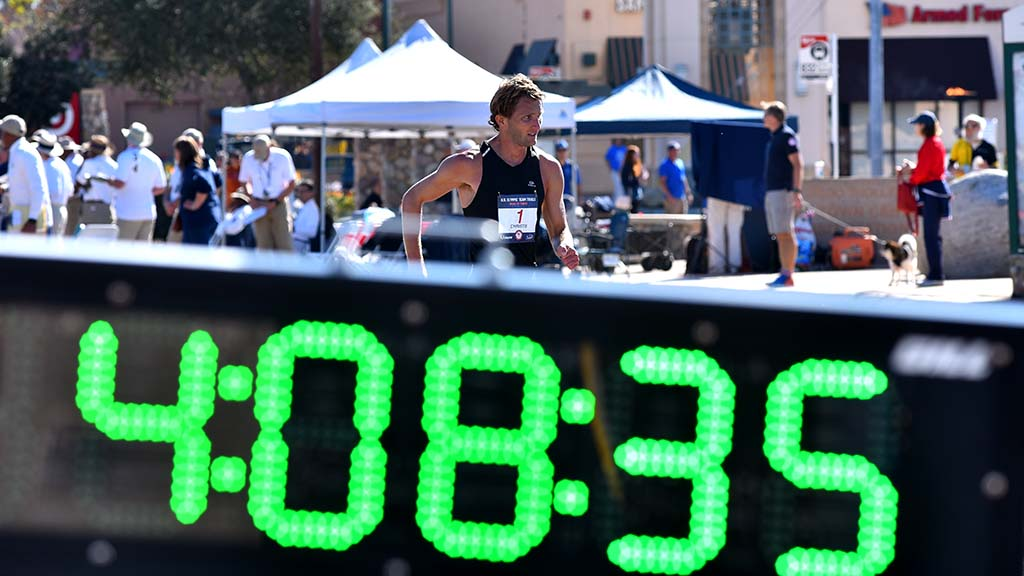 Nick Christie passes elapsed time clock during the sweltering portion of the race.