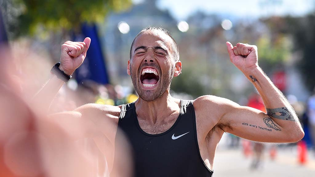 Matt Forgues exults after finishing second in the Olympic Trials 50K walk in Santee.